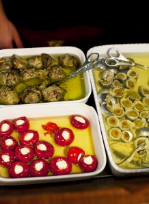 artichokes, stuffed peppers, and anchovy wrapped olives in olive oil